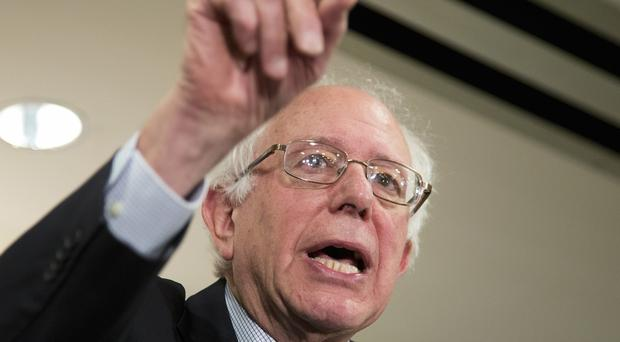 Democratic presidential candidate Bernie Sanders has denied stealing information about Clinton campaign voters (AP)