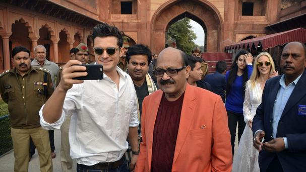 Orlando Bloom takes a selfie with Indian lawmaker Amar Singh at the Taj Mahal after a visa problem initially saw him being turned away from India (AP)