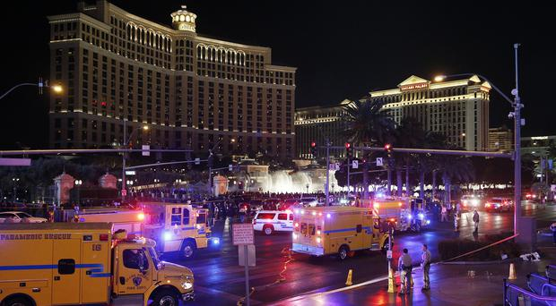 Police and emergency crews at the scene of the car accident along Las Vegas Boulevard (AP)