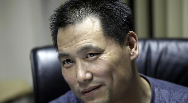 Pu Zhiqiang was found guilty, and given a suspended prison sentence (AP)