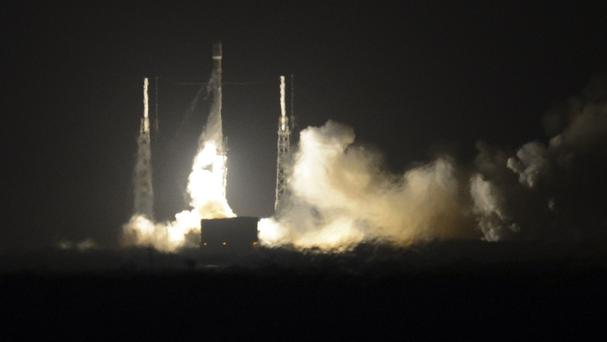 The SpaceX Falcon 9 rocket lifts off at Cape Canaveral Air Force Station (Florida Today/AP)