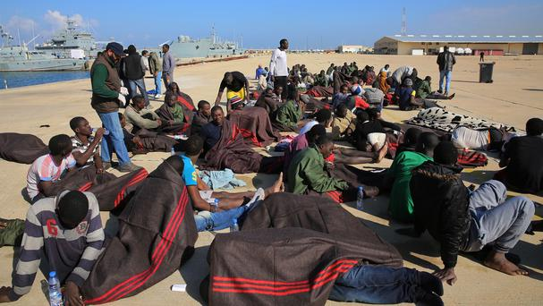 African migrants rest after being rescued by the Libyan coast guard west of Tripoli (AP)