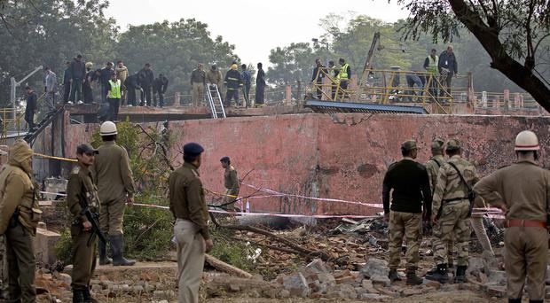 The scene of a small plane crash near the main airport in New Delhi, India (AP)