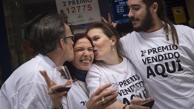 Cristina Ruiz, second left, is congratulated after becoming one of 1,600 winners of the Spanish Christmas Lottery (AP)
