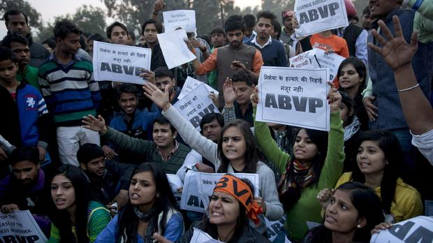 Protesters shout slogans as they condemn the release of a juvenile convicted in the fatal 2012 gang rape in New Delhi (AP)