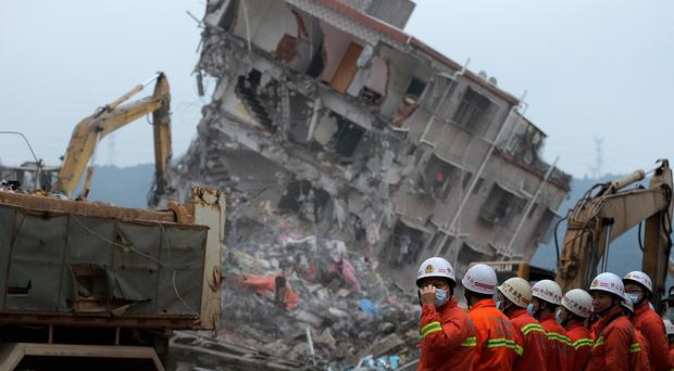 Rescuers search for potential survivors following the landslide at an industrial park in Shenzhen (AP)