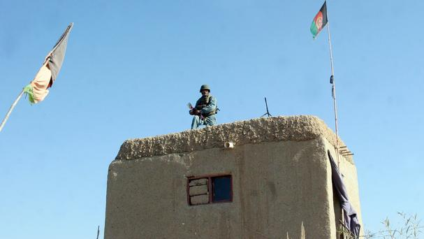 An Afghan soldier guards a checkpoint in Helmand province (AP)