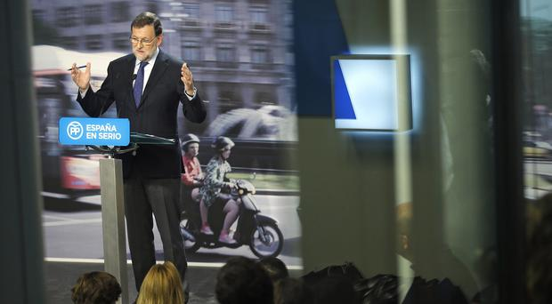 Mariano Rajoy addresses the media after failing to win a majority in parliament (AP)
