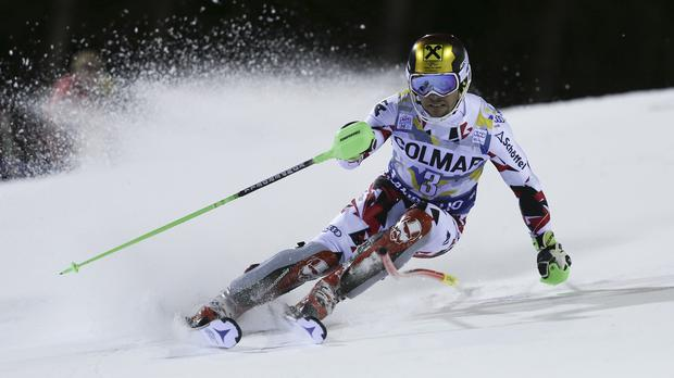 The drone crashed on the slope during a slalom run by Austria's Marcel Hirscher (AP)