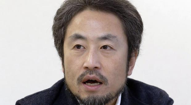 Jumpei Yasuda, speaking in Tokyo in February - a ransom demand has been made for the missing freelance journalist, it has been reported (AP)