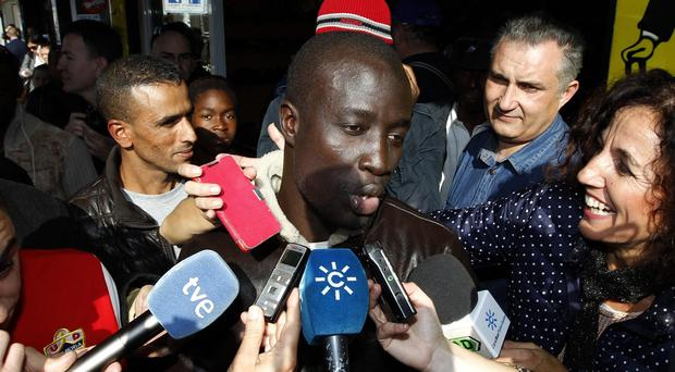 A Senegalese man named Ngame speaks after discovering he won 400,000 euro in Roquetas de Mar in Almeria province, Spain (AP)