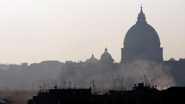 Smoke billows from chimneys in central Rome (AP)