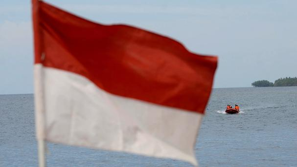Rescuers return to their ship from a search mission for the victims of a ferry that sank off Sulawesi Island last Saturday (AP)