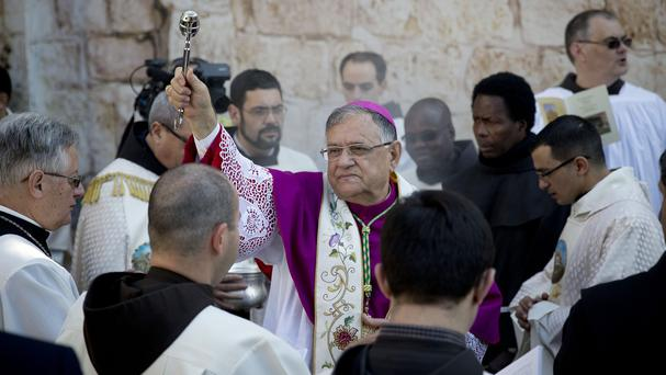 Latin Patriarch of Jerusalem Fouad Twal arrives at the Church of the Nativity, built atop the site where Christians believe Jesus Christ was born in Bethlehem (AP)
