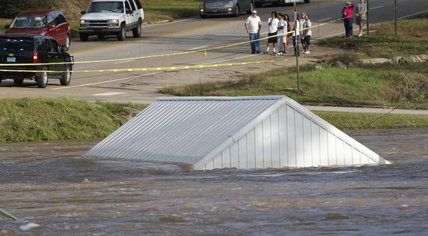 A building is submerged by the Pea river in Alabama (AP)