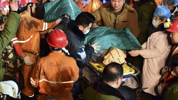 A miner being rescued after being trapped in a collapsed gypsum mine in China's Shandong Province (Xinhua/AP)