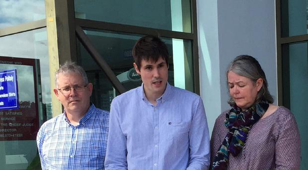 Michael Miller, flanked by his parents Ian and Sue, speaks after his brother's killers were sentenced to death