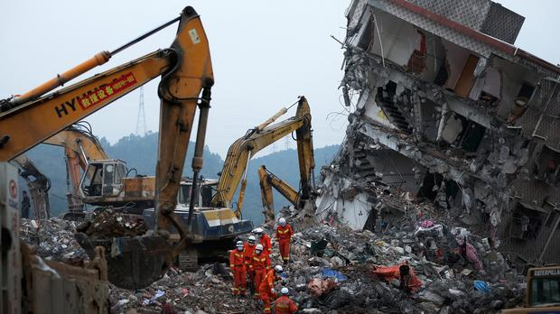 Rescuers working at the scene of the landslide at an industrial park in Shenzhen (AP)