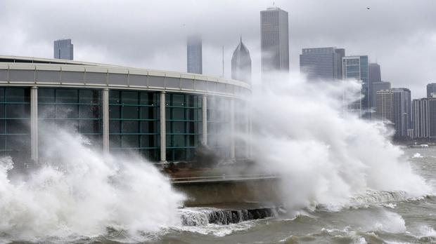 Waves from Lake Michigan smash against Chicago's Shedd Aquarium as the winter storm moves across Illinois (AP)
