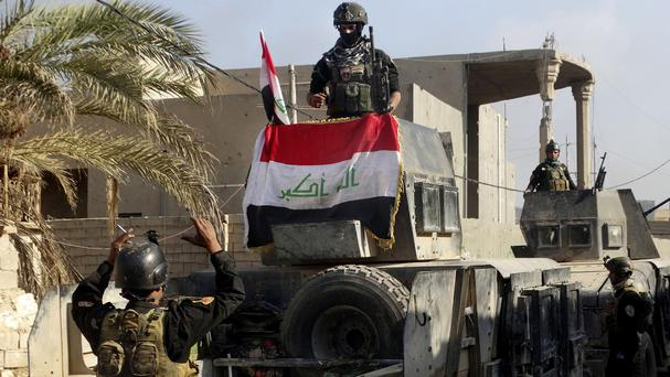 Iraqi security forces surround the government complex in central Ramadi (AP)