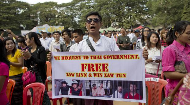 Protesters rally against a Thai court's verdict sentencing two Burmese migrant workers to death in Yangon (AP)
