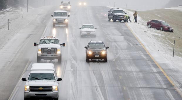 Snow, sleet, freezing rain and gusty winds created treacherous driving conditions across upstate New York (AP)