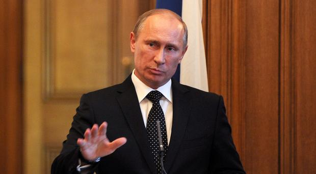 Russian President Vladimir Putin has called for co-operation in a message to his US counterpart Barack Obama