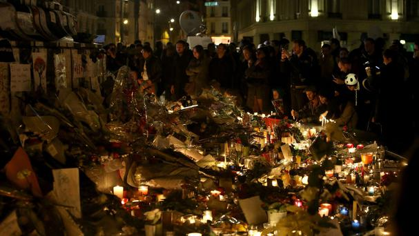 Floral tributes and candles left at Place de la Republique in Paris following the terrorist attacks in the city