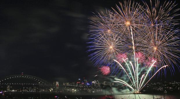 Fireworks explode over the Opera House and Harbour Bridge during the 9pm fireworks display in Sydney (AP)