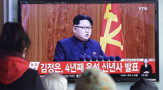 South Koreans watch North Korean leader Kim Jong Un's New Year speech (AP)
