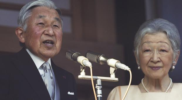Japan's Emperor Akihito, who appeared with his wife Empress Michiko, delivers a speech to well-wishers from the Imperial Palace (AP)