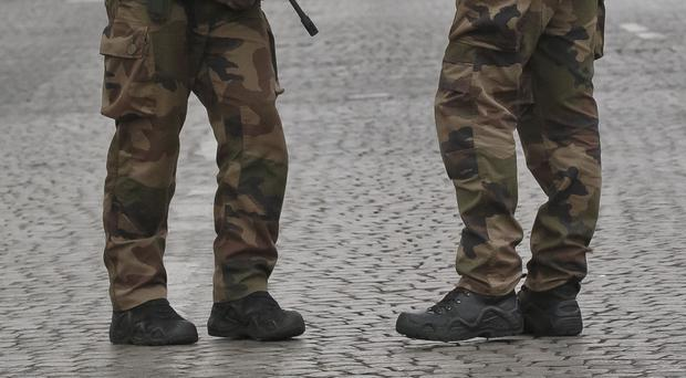 One soldier was slightly injured in the leg, and a passer-by was hit in the leg by a stray bullet (AP)