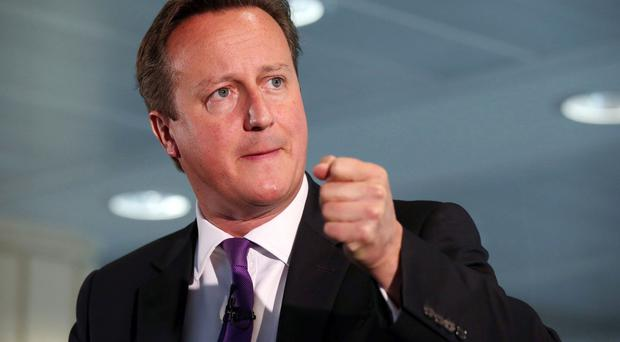 An IS militant issues a warning to David Cameron in a video