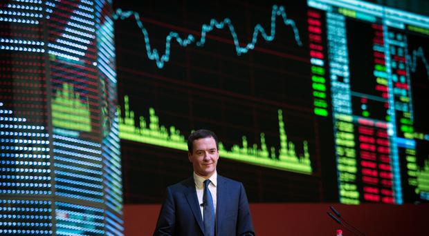 The Shanghai Stock Exchange, pictured during a visit by Chancellor George Osborne