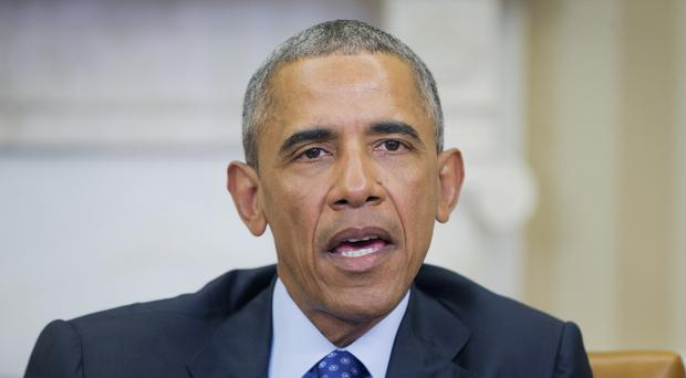 Barack Obama at a meeting in the Oval Office of the White House to discuss ways to curb gun violence (AP.