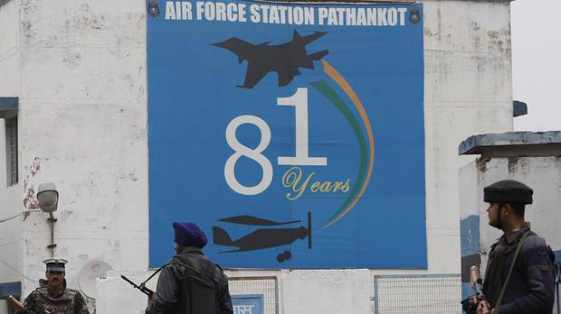 Indian soldiers stand guard outside an air base in Pathankot, India (AP)