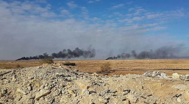 Smoke rises following a US-led coalition air strike on Islamic State group positions, outside Haditha (AP)