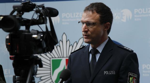 Police spokesman Christoph Gilles speaks during an interview with the Associated Press in Cologne, Germany (AP)