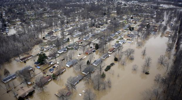 Houses were surrounded by flood water in Arnold, Missouri, during 2015 (AP)
