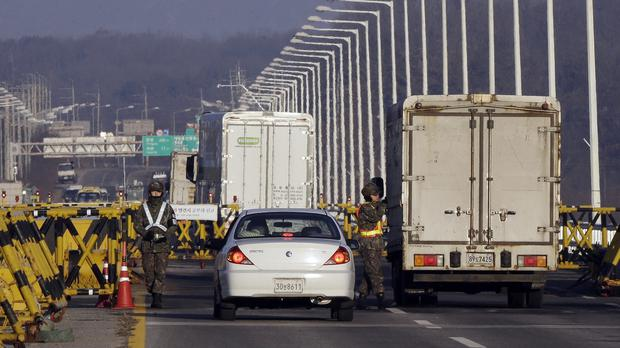 South Korean soldiers at a check point at Unification Bridge in Paju , as Seoul resumed broadcasting anti-Pyongyang propaganda (AP)