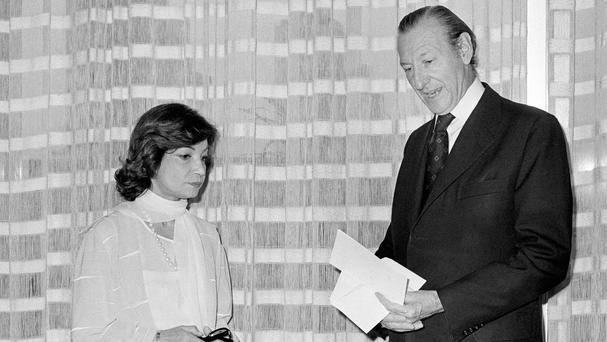 Princess Ashraf Pahlavi of Iran talks with UN secretary-general Kurt Waldheim during the International Women's Year Conference in Mexico City in 1975 (AP)