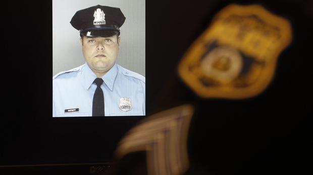Officer Jessie Hartnett was shot in the attack (AP)