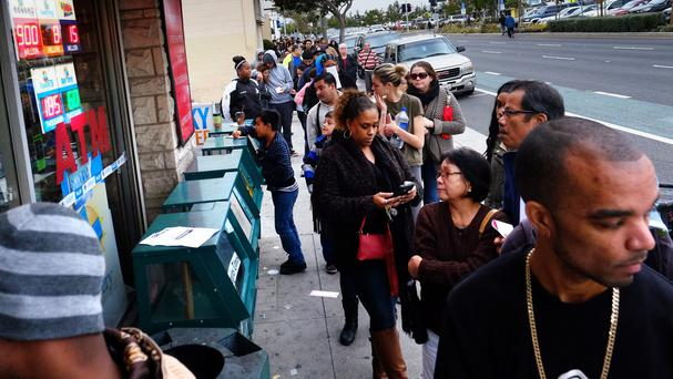 Customers queue at the Blue Bird Liquor Store to buy Powerball lottery tickets in Hawthorne, California (AP)