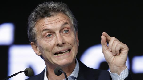 President Mauricio Macri was embarrassed by false claims that all three fugitives had been recaptured (AP)