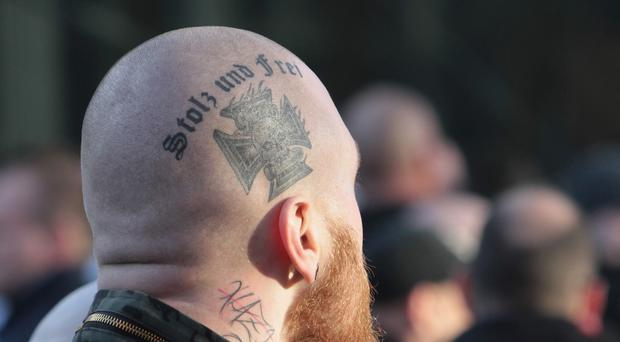 A right-wing demonstrator with a tattoo reading