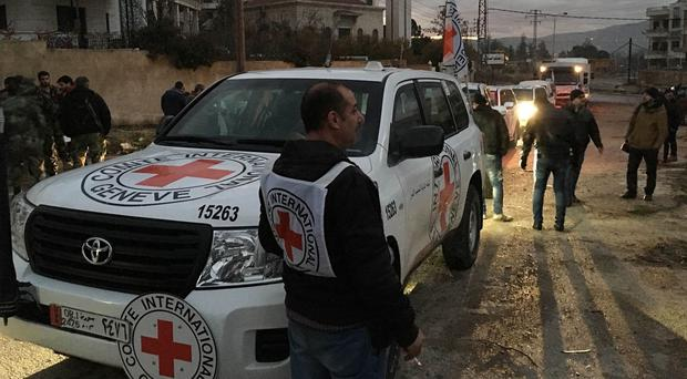 The convoy delivers aid to the town of Madaya in Syria (International Committee of the Red Cross/AP)