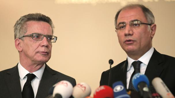 German Interior Minister Thomas de Maiziere, left, and his Turkish counterpart Erkan Ala give a press statement in Istanbul, Turkey. (AP)