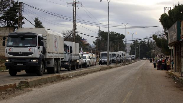 A convoy of vehicles loaded with food and other supplies makes its way to the besieged town of Madaya (AP)