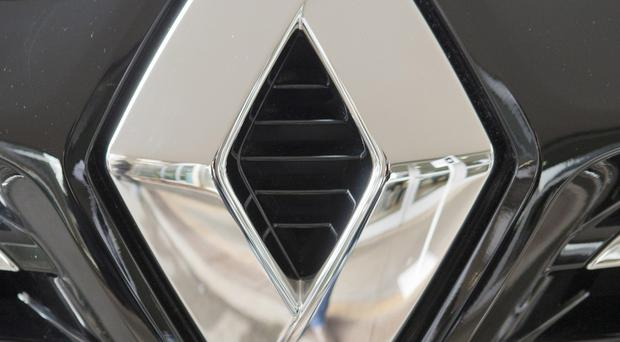 Renault's shares have fallen following the raids. (AP)