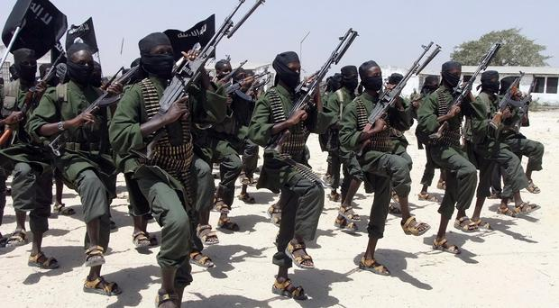 Newly trained al-Shabab fighters perform military exercises in Lafofe (AP)